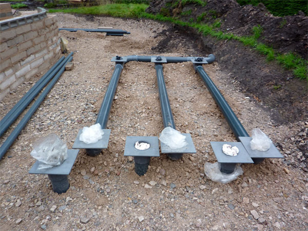 Underground drainage for the filters has now been completed perfectly with the necessary base plates to give perfect levels throughout