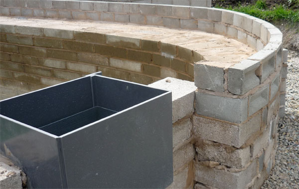 Close-up of the wall bed that will support the large rocks used in final landscaping of the pond.