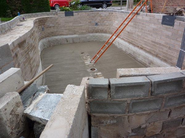 """Final base cast with a 5"""" (12.5cms) fall from vertical pond walls to a flat central area 18"""" (45cms) around the pond drains"""
