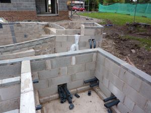 Shows exit lines for the pond underfloor heating system as well as initial preparations for items to be installed into the equipment housing
