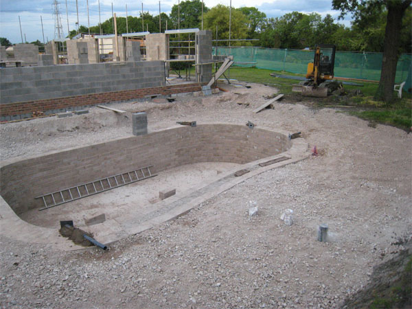 area surrounding the pond has now been partially back-filled and the pond walls have stopped