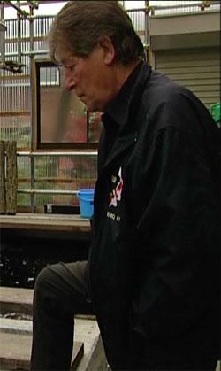 Peter Waddington looking at koi