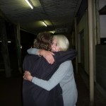 Hilary and Peter Waddington hugging in street